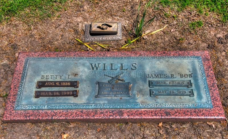 Grave Marker Wide Shot Tombstone of Wester Swing Music Bob Wills in Tulsa Oklahoma. A full view of the final resting place and tombstone of the famous Bible royalty free stock photography