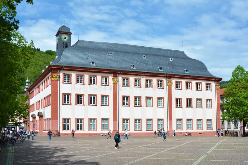 Full view of old historical university building that is now used as meeting or concert hall in city center. Heidelberg, Germany - April 2019: Full view of old stock photos