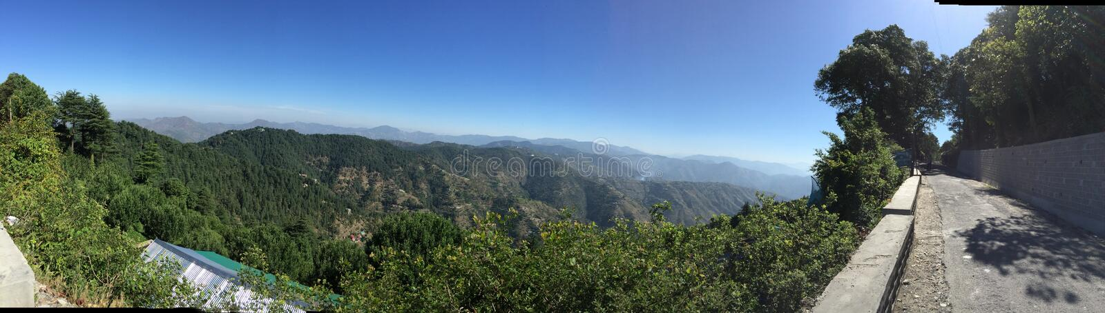Full View from the top of Chail, Himachal Pradesh, India. A panoramic photo of the Chail, Himachal Pradesh, India. Spanning across to view is also the of Shimla' stock photography