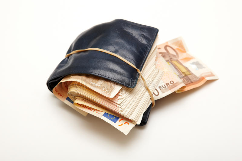 Full wallet. Wallet full of money tied with a rubber band stock image