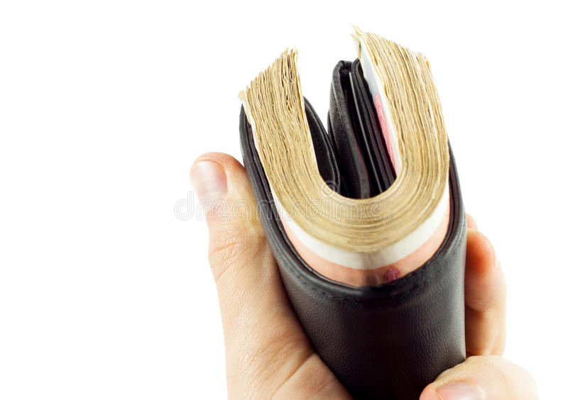 Full wallet. Wallet full of money, isolated on a white background royalty free stock photo