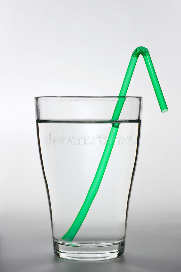 Download A Full Water Glass With A Green Drinking Straw Stock Photo - Image: 13025924