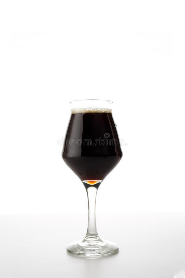 Fullt öltulpanexponeringsglas av kraftigt eller portvakt som isoleras på vit bakgrund royaltyfria foton