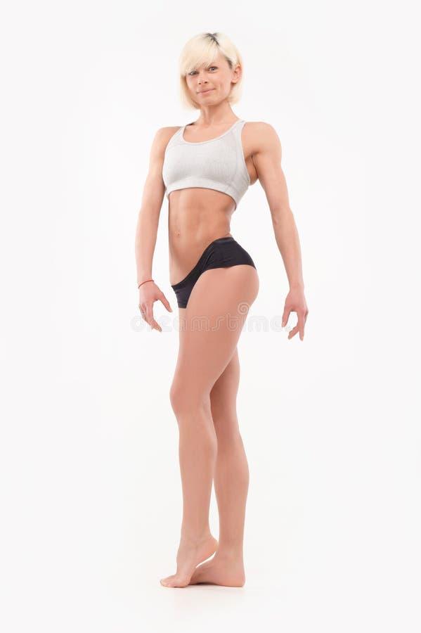 Fullt kroppskott av kvinnliga idrotts- former fotografering för bildbyråer