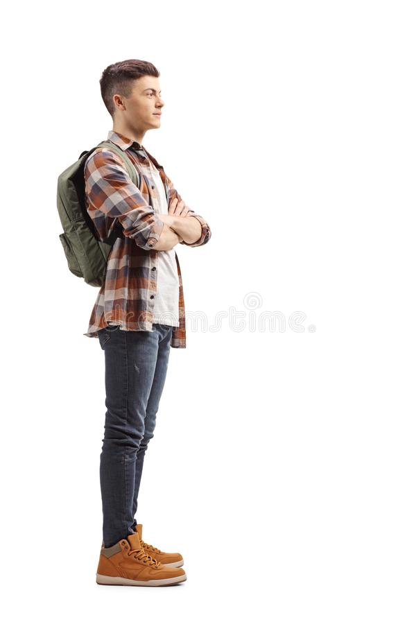 Fullt längdprofilskott av ett tonårs- anseende för manlig student och royaltyfria bilder
