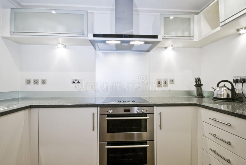 Download Fully Fitted Contemporary Kitchen In White Stock Photos - Image: 14466943