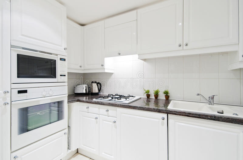 Fully fitted white kitchen royalty free stock photos