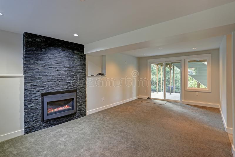 Fully renovated living area with black fireplace royalty free stock images