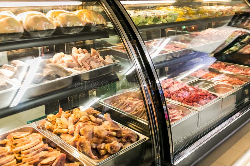 Fully stocked butchery and deli section at local Pick n Pay grocery store. Johannesburg, South Africa - October 27, 2016: Fully stocked butchery and deli section royalty free stock images