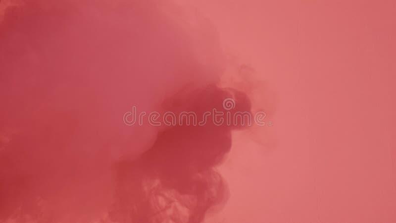 Fumée avec la lumière rouge image stock