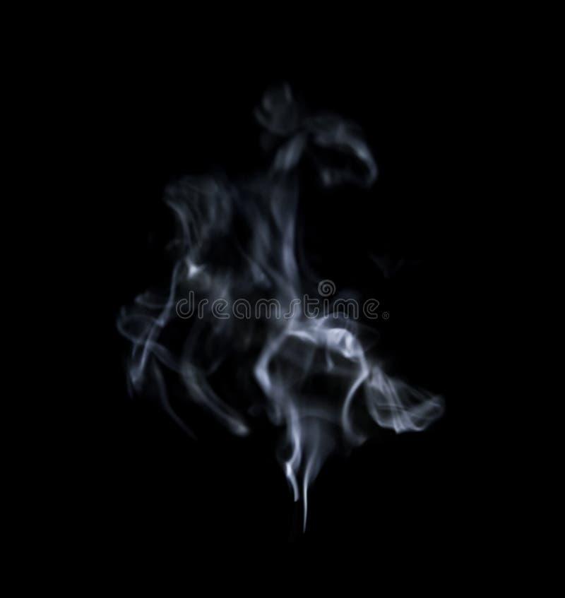 Fumée blanche sur le fond noir image libre de droits