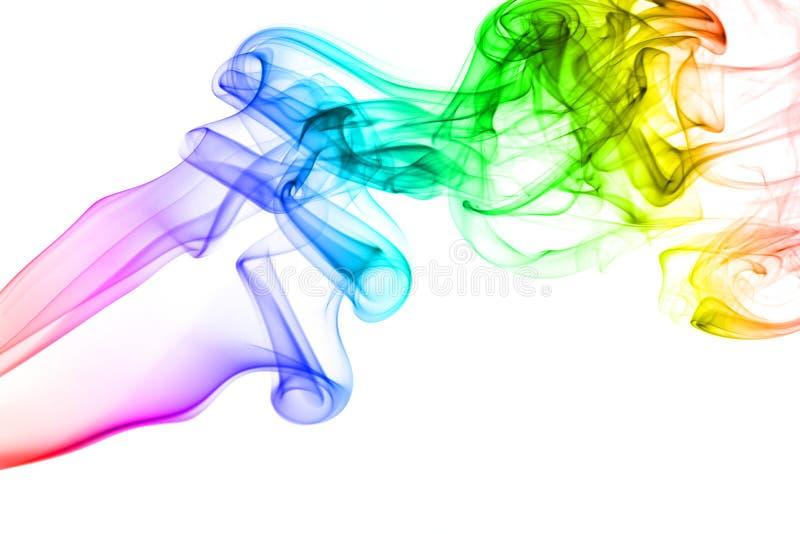 Fumée d'arc-en-ciel d'isolement sur le fond blanc photographie stock libre de droits