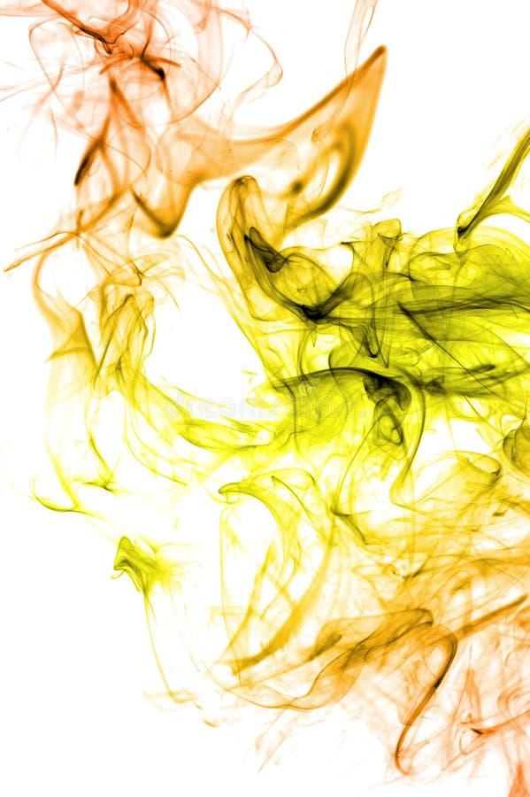 Fumée de couleur sur le fond blanc images stock