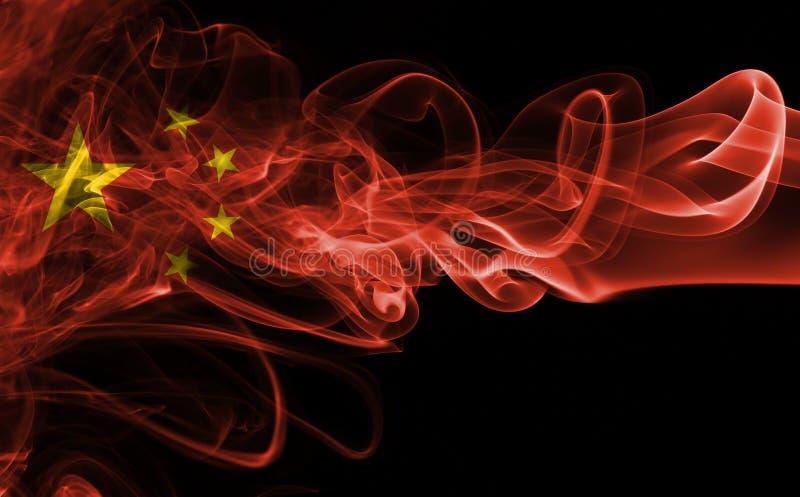 Fumée de drapeau de la Chine images stock