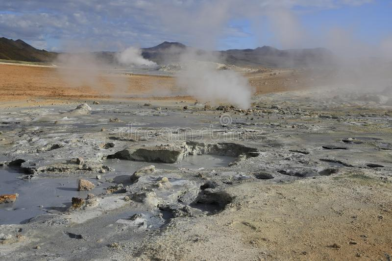 Fumaroles volcanic boiling mud pots. Surrounded by sulfur hot springs in Hverir Namafjall geothermal place in Iceland royalty free stock photography
