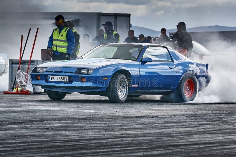 Fuming blue car racing stock photos