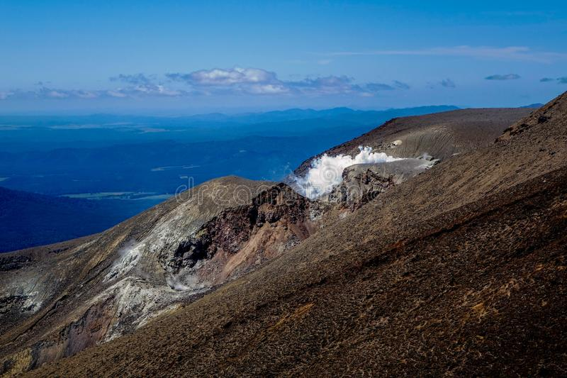 Fuming Geothermal vents on Volcanic landscape stock image