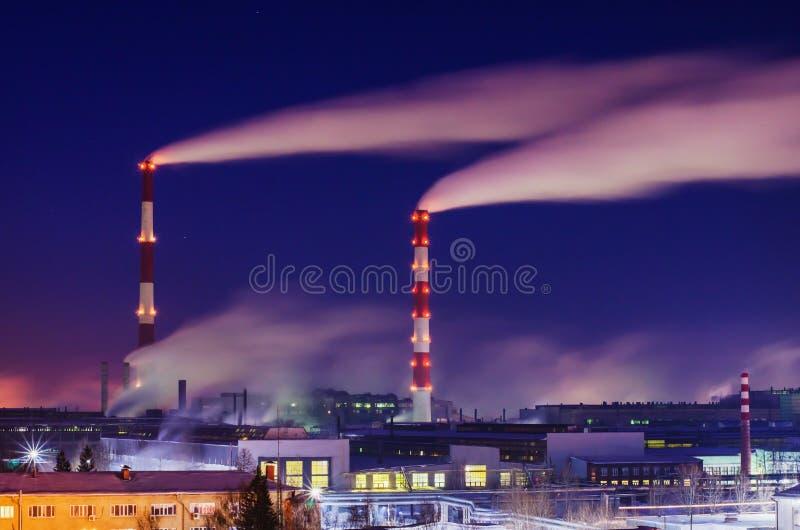 Fuming smokestacks plant stock image