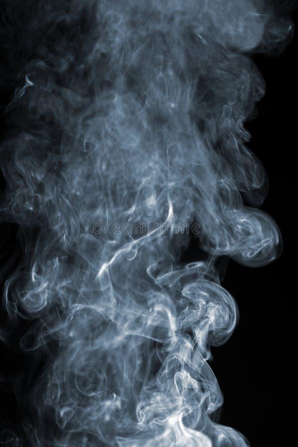 Fumo astratto sopra il nero fotografia stock