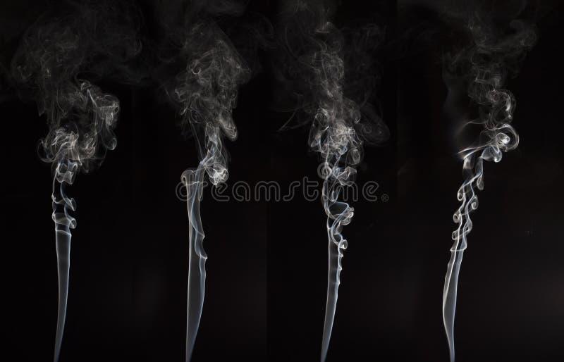 Fumo branco no fundo preto fotografia de stock