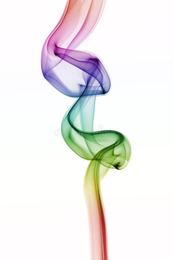 Fumo colorido abstrato do arco-íris isolado no fundo branco foto de stock royalty free