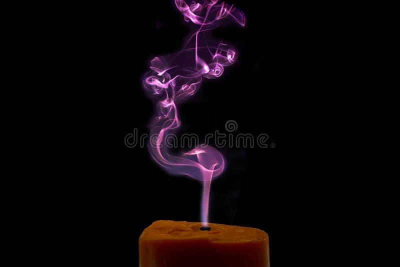 Fumo colorido da vela imagens de stock royalty free