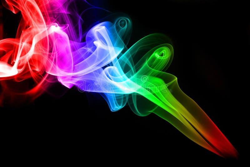 Fumo colorido do arco-íris imagem de stock