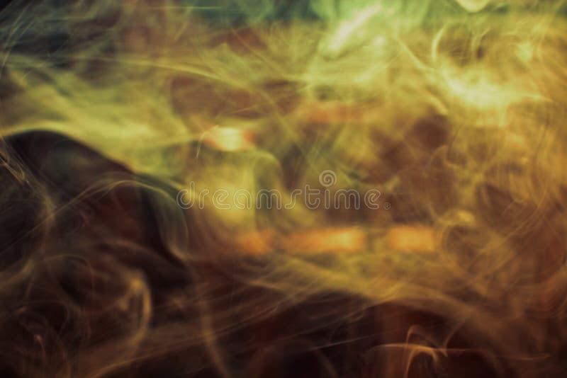 Fumo dorato fotografia stock libera da diritti