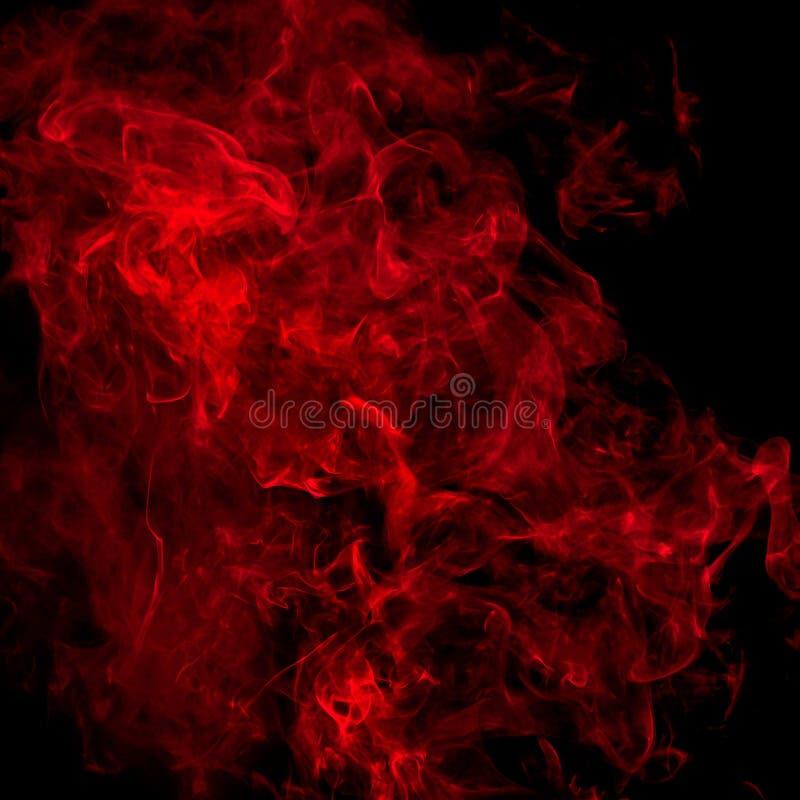 Fumo rosso sopra il nero immagine stock