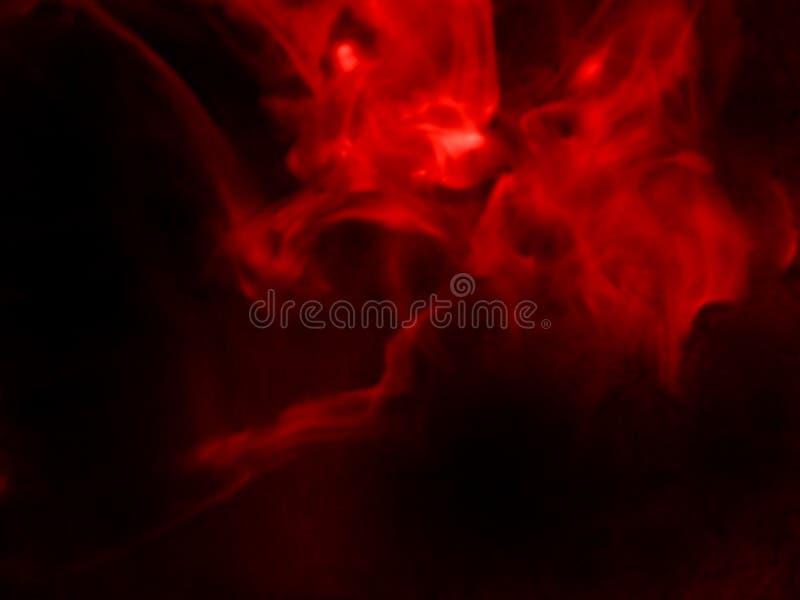 Fumo vermelho fundo preto isolado N?voa abstrata da n?voa do fumo em um fundo preto Textura imagem de stock royalty free