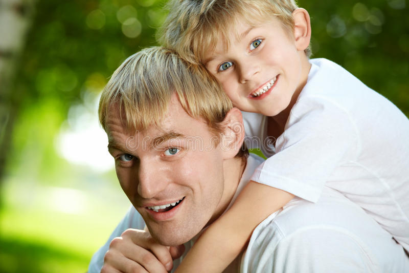 Fun. Daddy carries on a back of small son