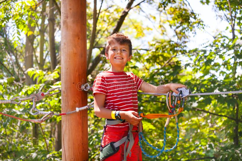 Fun at adventure rope park little boy portrait stock photography