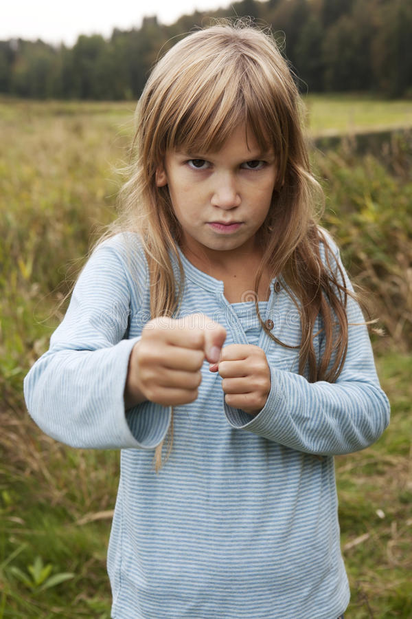 Fun angry little girl. stock photos