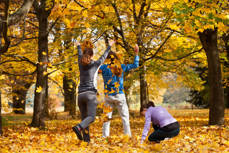 Fun with autumn leaves stock photography