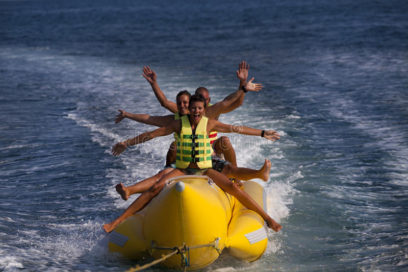 FUN BANANA BOAT. People riding on a banana boat royalty free stock photo