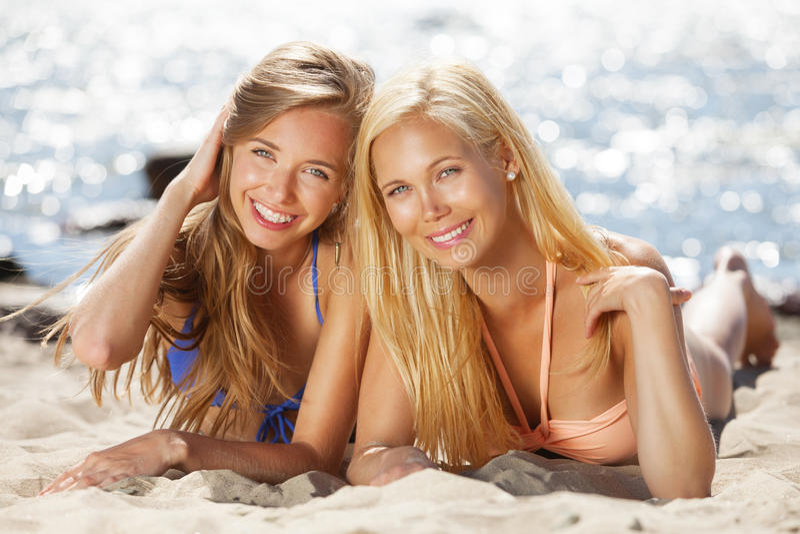 Fun on the beach. Girlfriends having good time on the beach stock photos