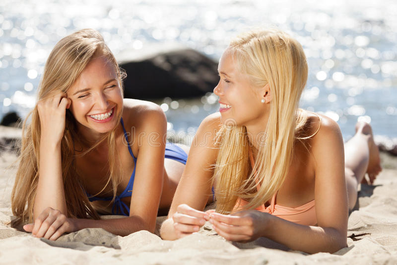 Fun on the beach. Girlfriends having good time on the beach stock photo