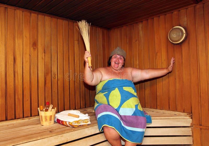 Fun big woman in sauna royalty free stock photos