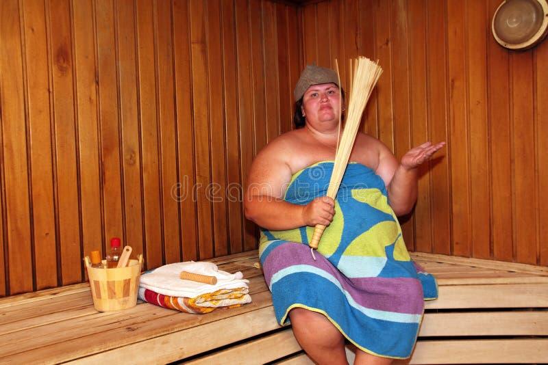 Fun big woman in sauna stock photography