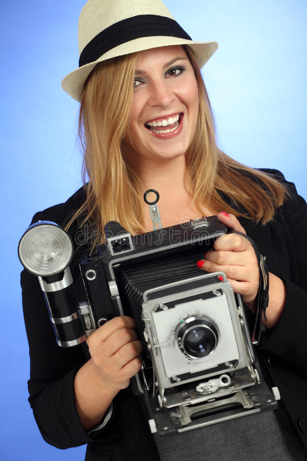 Download Fun Blond Female Holding Old Camera Stock Photo - Image: 25995552