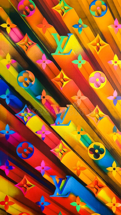 2019 fun and bold window display rainbow monogram wallpaper background at the Louis Vuitton Flagship Store royalty free stock photo