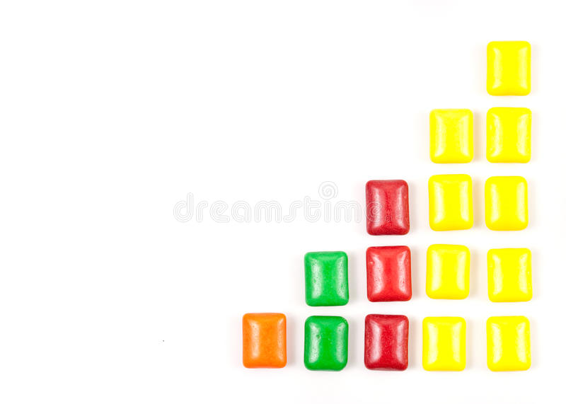 Fun with Chewing Gum. Colorful Chewing Gum in Staggered Formation on white with custom space for text and pictures stock photography