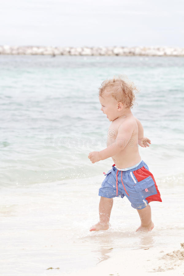 Download Fun: Child On Tropical Beach Royalty Free Stock Images - Image: 20394319