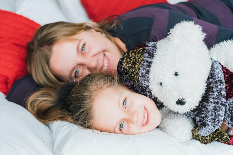 Fun childhood loving mother daughter teddy bear royalty free stock images