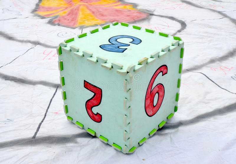 Fun colorful toy puzzle cube or dice in textured foam for kids to learn their numbers 2 , 3,9 stock images