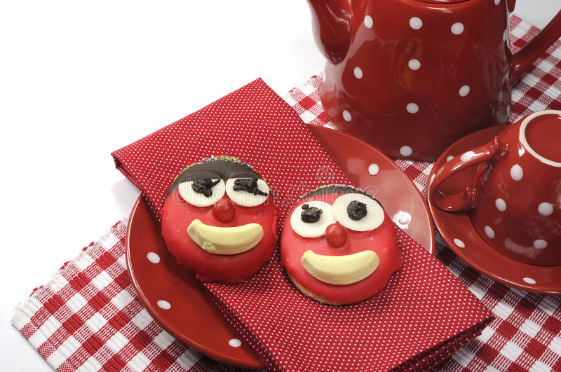 Fun cute childrens handmade cookie with candy face and red polka dot cup of tea or coffee. For Mothers Day, birthday or Fathers day with sample text or copy royalty free stock photos