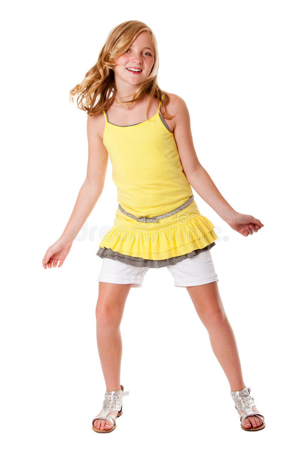 Fun and dancing girl. Beautiful cute blond girl having fun dancing fashion dressed in layered yellow shirt, white shorts and belt, isolated stock photos