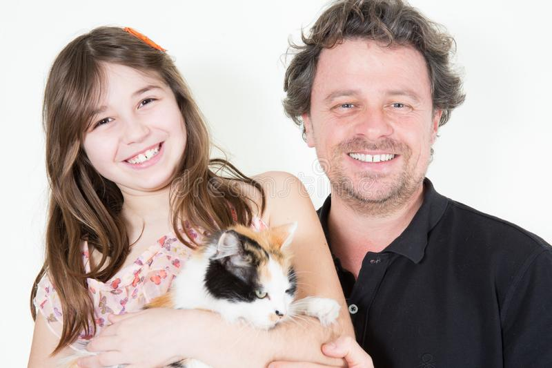 Fun daughter with happy smiling father and cat in arms royalty free stock photo