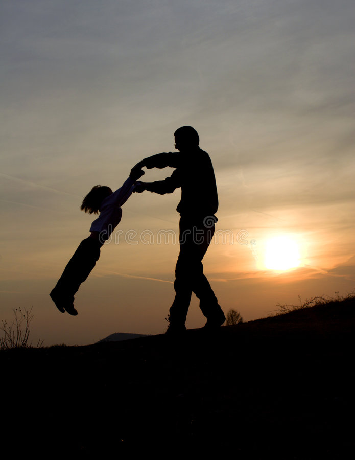 Fun of father and child in sunset royalty free stock photo