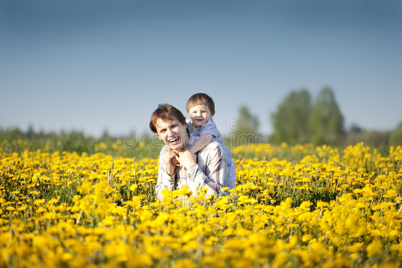 Fun in the field of dandelions royalty free stock images